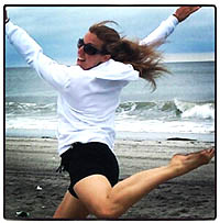 Sheri leaping on the beach